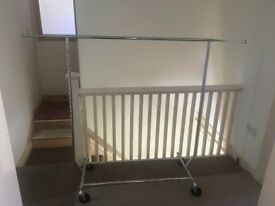 Clothes rail - ex retail strong, 6 foot long, 5 foot high, folds up for car, on rubber wheels.