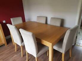 Solid wood extendable dining room table and 6 chairs