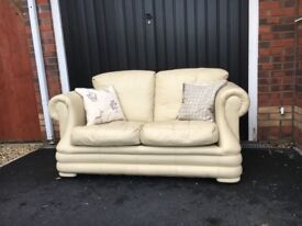 Cream Leather 2 Seater Sofas and Foot Stool
