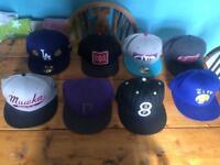 Selection of NBA baseball hats.