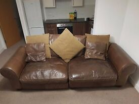 BIG LEATHER SOFA VERY COMFY GOOD QUALITY IN GOOD CLEAN CONDITION SPLITS INTO TWO CAN ARRANGE DELIVER