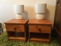 Two pine bedside tables with lamps