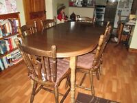 dark oak dining table and 6 chairs in good condition bargain