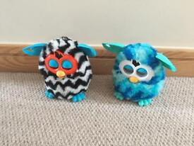 Two interactive furbies