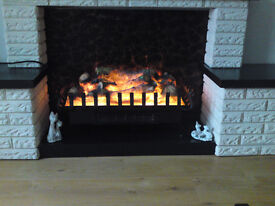 Fan assisted, log effect, electric fire.