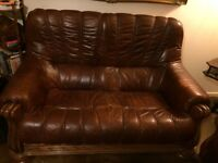 Set of two brown leather sofas and armchair DFS