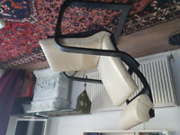 Cream leather ikea chairs with black wooden base