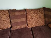 Brown material corner sofa and chair