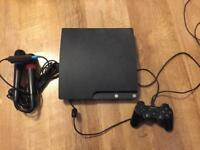 PlayStation 3 with 9 games, 1 controller & 2x sing star mics