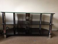 Black glass TV stand. L(105cm) x W(45cm) x H(52cm).