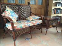 Two seater cane / wicker sofa and glass top table