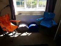 Camping chairs and sleeping bags