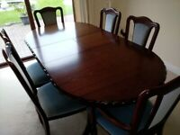 Mahogany dining table with 6 chairs by John Coyle