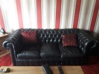 Chesterfield black leather sofa and queen anne chair with footstool