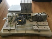 Wii bundle with Wii fit board plus games, two controllers and accessorises