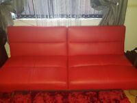 Red leather click clack sofa bed