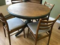 Lovely refurbished dining room table and four reupholstered vintage style chairs
