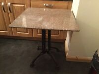 Marble topped table with cast iron legs. 68 x 68 cm and Hight 73cm