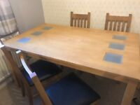 Light oak dining table with four chairs