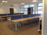 BENCH DESKING IN MAPLE . 1200 X 800 PER PERSON , USED EXCELLENT CONDITION - (44 POSITIONS )