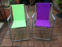 2 small folding garden chairs.