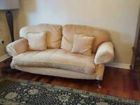 Gold colour suite in excellent condition. 2 sofa's 1 chair and footstool.