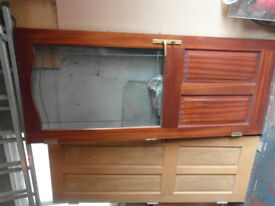 Soild mahogany door with double glazed unit and tripple locking mechanism.