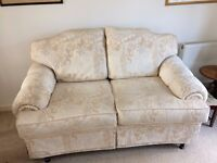 2 Seater ivory brocade sofa complete with Fire compliance label attached