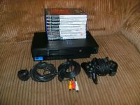 Sony PS2 complete with controller(s) and 16 games.