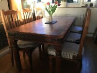 Solid wood Indian Rosewood table and six chairs