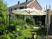 Cantilever Parasol Complete with base and cover Little Used EXCELLENT CONDITION!FOR SALE!
