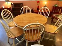 Round extending dining table with 6 chairs