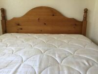 A pine headboard for a double bed