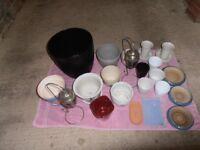 An assortment of indoor & outdoor Plant pots & pot holders.