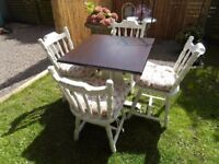 Lovely cottage style table and chairs in Antique White. (Please make an offer )