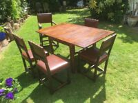 Vintage original collectable mahogany extending dining table and 5 leather chairs