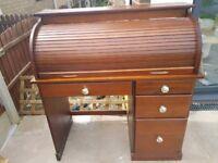 Lovely roll top desk. Smaller size. Single pedestal.