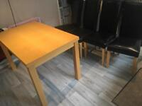 Table and 4 Chairs with seat covers
