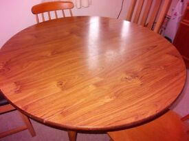 Drop leaf round table, 42ins. diameter with 2 matching chairs plus 2 other dining chairs
