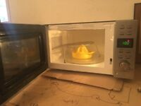 Sleek efficient microwave with extras
