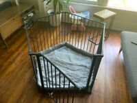 Metal playpen with padded base