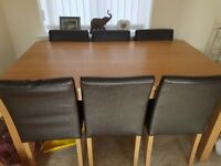 6 brown faux leather dining chairs ( table included if wanted)