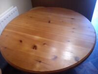 Round pine table, sanded and oiled. No chairs