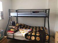 Black metal triple bunk bed
