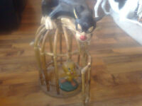 sylvestor and tweety pie in a bamboo cage
