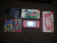 Nintendo Switch lite console with Lego game and case