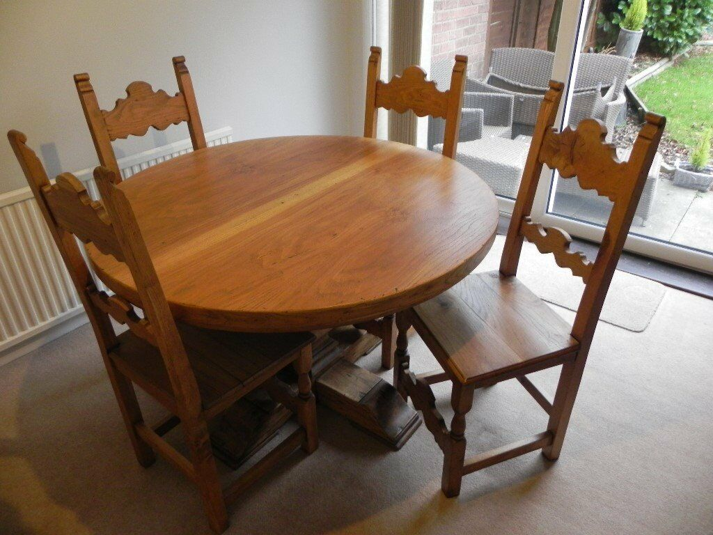 Dutch Oak Round Table And Four Chairs In Bramcote