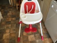 Mamas and Papas contemporary highchair in red..Quite compact.Lightweight and easy to transport