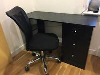 Black wood desk and office chair