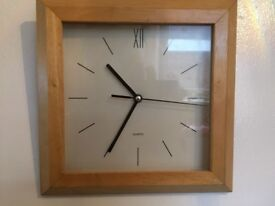 Square clock in a wooden frame